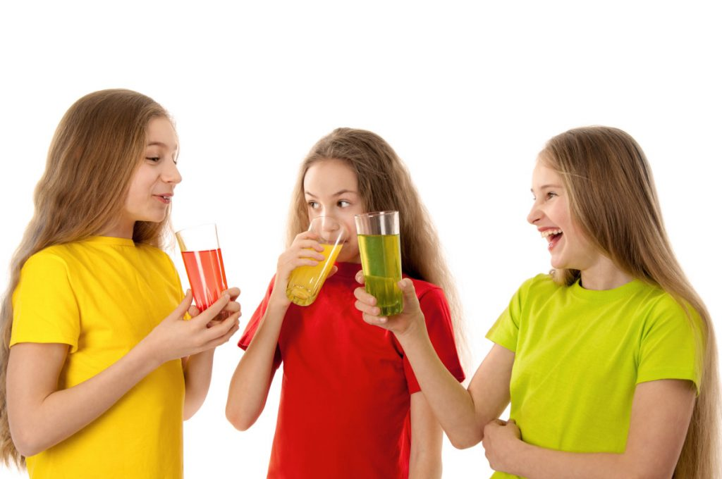 Happy children drinking juice